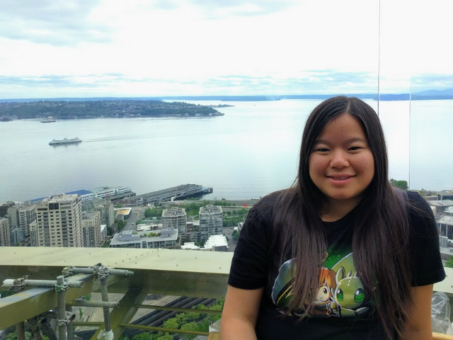 Photo of Jenny Wong with city view.